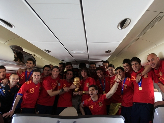 Spain's soccer team players pose inside their plane before landing in Madrid